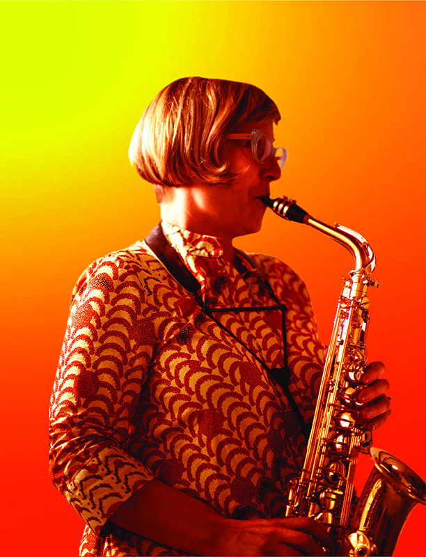 White female with short blond hair and glasses playing saxophone